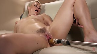 Quick haired blonde Helena Locke rides a fucking machine