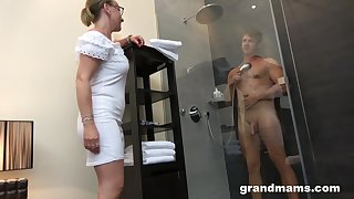 Jocular mater with high sex drive enjoys watching young man taking a shower before having sex