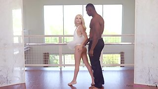 Agreeable blonde tolerant with adjacent tits is having interracial sexual intercourse with a handsome, black man
