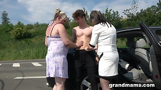 Two chubby full-grown women bang young student on the road