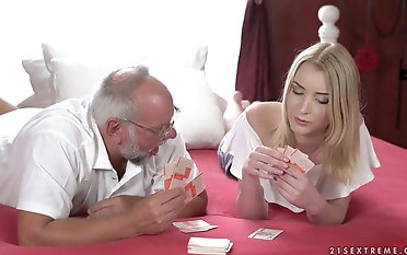 Magnificent young blonde Amaris is effectuation strip poker with one old fart